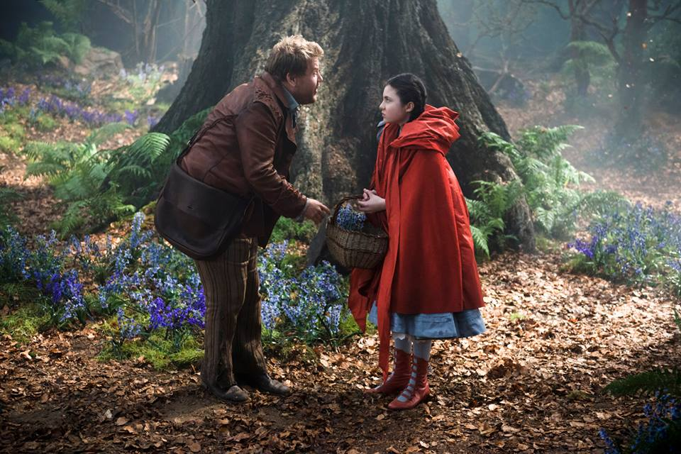 The Baker and Little Red Riding Hood in front of a large tree on set