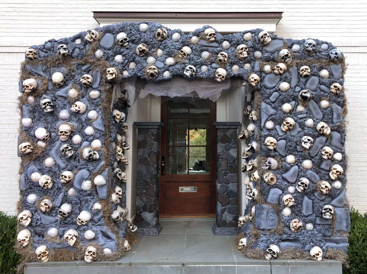 This archway of foam skulls is a perfect example of durable Halloween scenery.