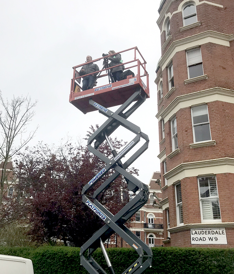 Rosco's Sarah Horton - three stories up - shooting the original photos that would be used to create the background imagery for The Father.